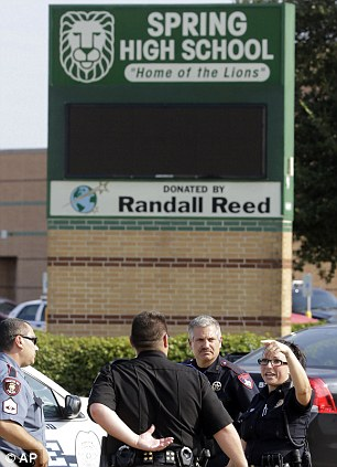 Law enforcement officers gather outside Spring High School Wednesday, Sept.