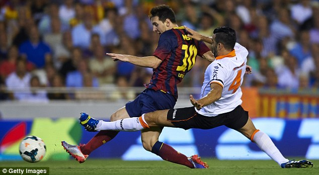 Prowess: Messi scored a hat-trick in Sunday's 3-2 win over Valencia