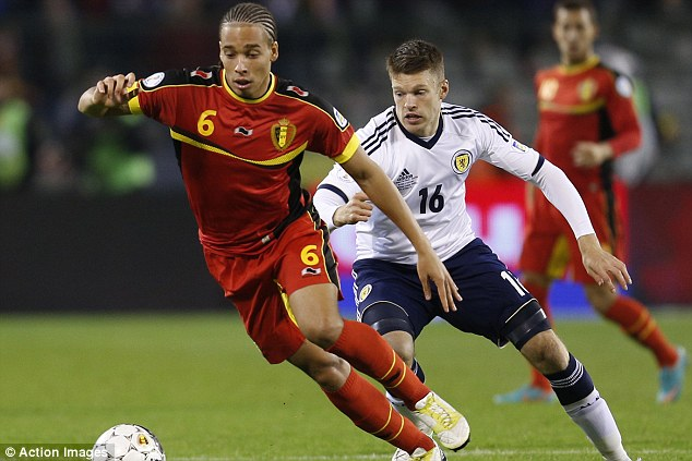 Beat this: Alex Witsel is chased by Jamie Mackie of Scotland