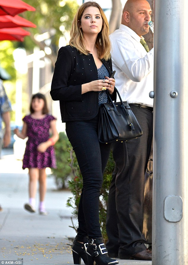 Back to black: Ashley sported a chic jacket, jeans and silver belted boots for lunch with her manager and agent