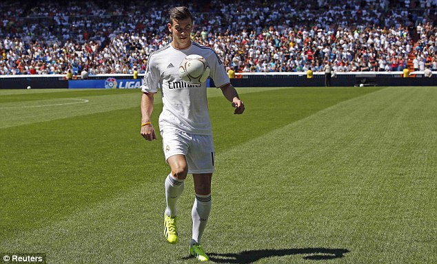 Unveiling: Bale was paraded on the Bernabeu pitch after becoming the world's most expensive player