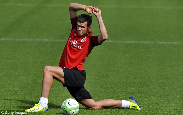Limbering up: Bale training with Wales before their World Cup qualifier