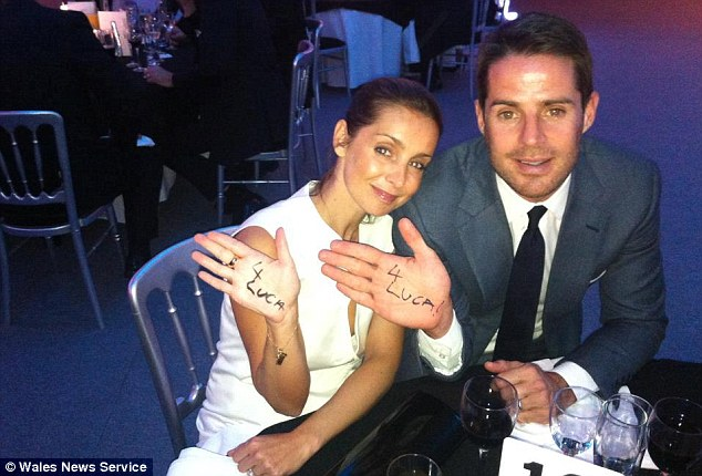 Giving him a hand: Sportsmail columnist Jamie Redknapp and wife Louise show their support for the 'For Luca' campaign