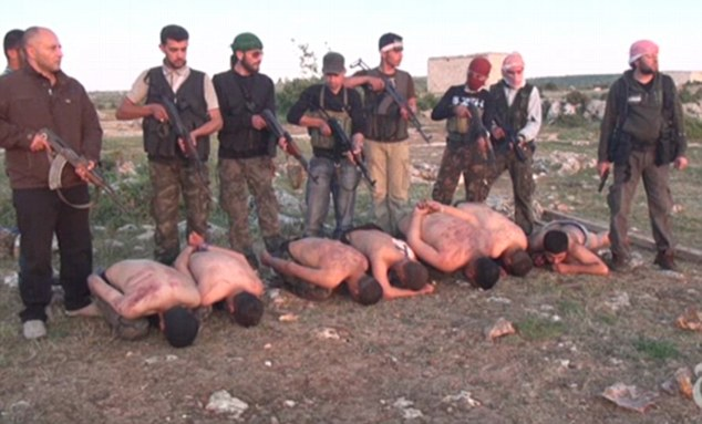 Horrific: The soldiers are stripped, bound and pushed to the ground where a number of rebels stand over them pointing guns at their bodies before they are shot