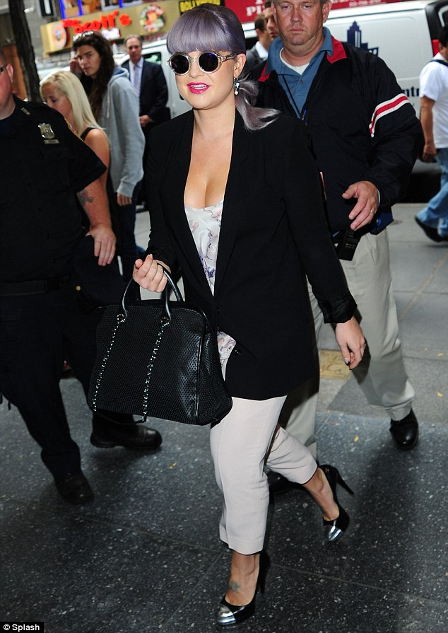 Morning comfort: Kelly went for a slightly less dressy ensemble as she arrived at The Today Show