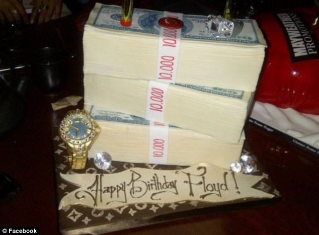 Bet it tastes rich: This cake - celebrating his favourite things - was made for Mayweather's birthday last year