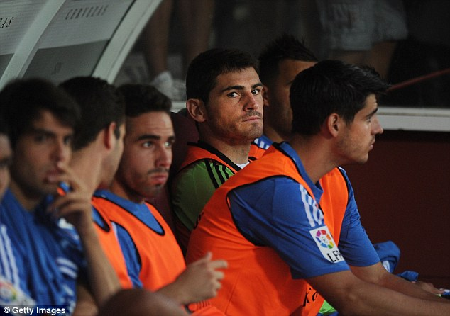 Benched: Casillas looks out from the subs bench during the La Liga match against Granada