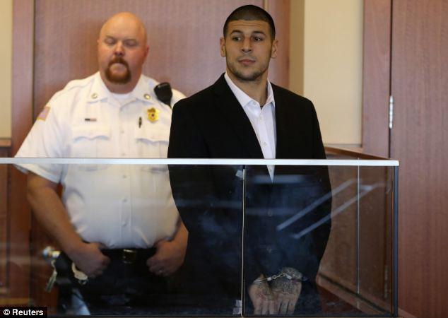 Denial: Former NFL New England Patriots tight end Aaron Hernandez, pictured in court on Friday, has pleaded not guilty to first-degree murder in the shooting death of Odin Lloyd
