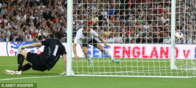 Using his head again: Rickie Lambert stoops to head in England's second