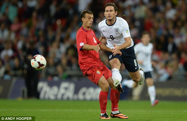 Fully committed: Frank Lampard thunders in for England