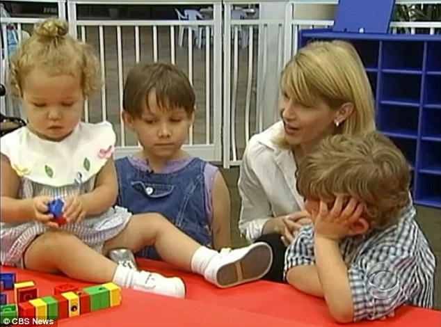 Tough start: Taylor (second left), pictured as a boy with his two sisters, entered the foster system in 2003 after being removed from the home of his drug-addict parents