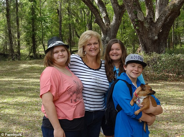 Happy family: Taylor (far right) now lives with Connie Going and her two daughters in Clearwater, Florida
