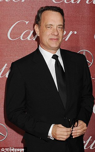 Doppelganger: Colin Hanks is the image of his famous father Tom as he attends the premiere of his new movie Parkland in Toronto on Friday