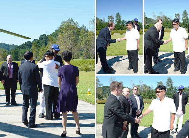 This photo - released by the North Korean government - shows members of Rodman's entourage as they are greeted by Kim