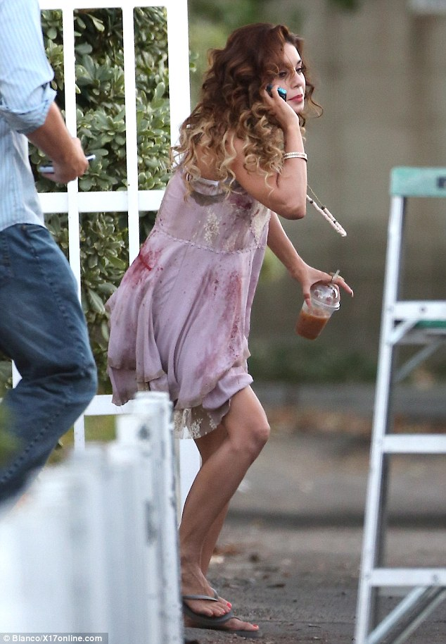 The young actress was seen chatting on her phone while clutching an iced drink on the hot day