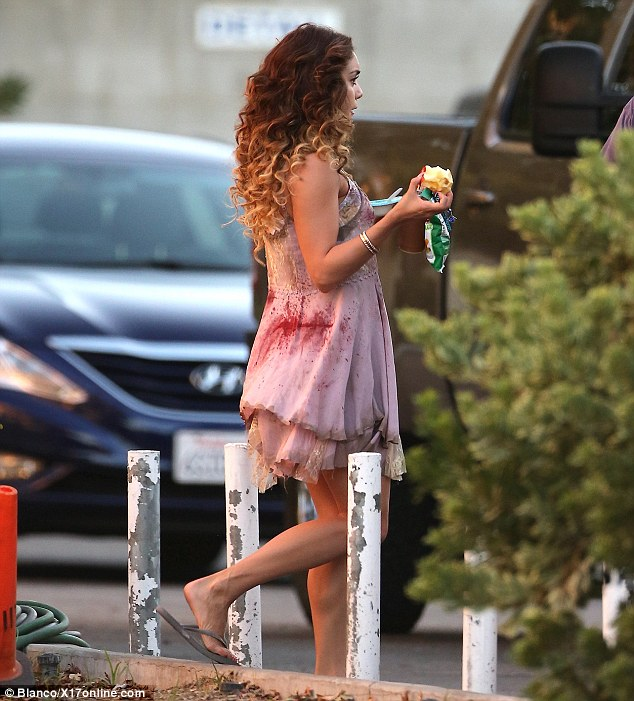 Meal for one: The actress' hair looked extremely curly as she filmed scenes for Kitchen Sink