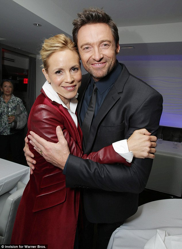 Cosy co-stars: Maria Bello stood out in a ruby red leather and suede jacket as she enjoyed a cuddle with her on-screen husband inside the screening