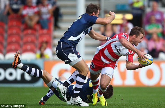 Offload: Gloucester's Henry Trinder passes under pressure from Sale's Andy Forsyth