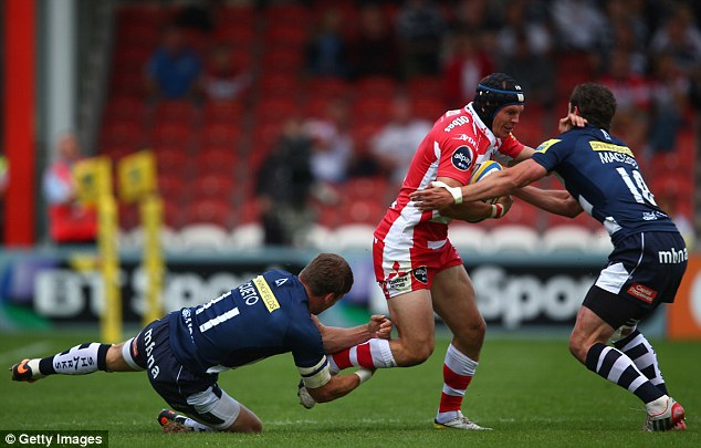 Doubling up: Rob Cook of Gloucester is held up by Sale's Mark Cueto and Nick Macleod