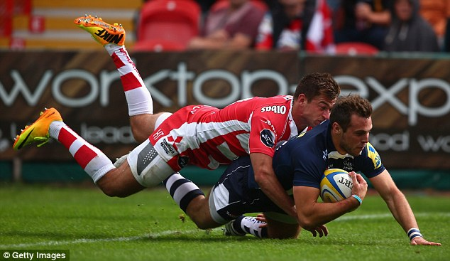 Match-winning: Sale's Andy Forsyth dives over to score a second-half try for the away side