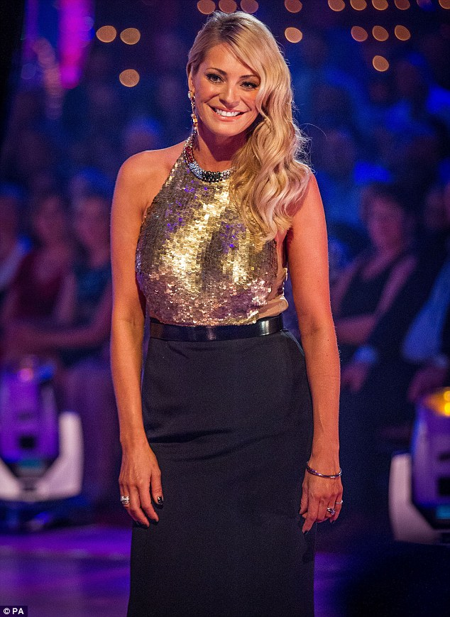 Strictly presenter Tess Daly looks stunning in gold and black sequined dress