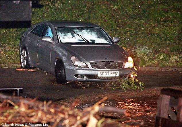 A Mercedes Benz car is left badly damaged badly damaged after being swept away in Saltburn, Cleveland, last night