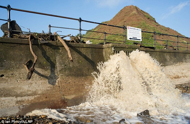 Water pours from a run off pipe in Saltburn, Cleveland, onto the beach following an evening of torrential rainfall that caused flooding and disruption across parts of the northeast