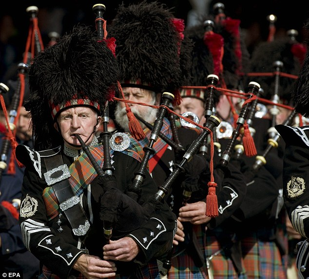The massed pipe bands perform for the crowd