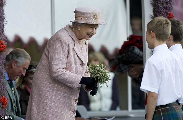 Gift: The monarch receives a bouquet from some youngsters