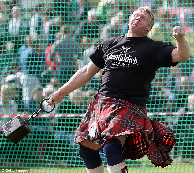 Heave: A competitor throws a weight during the games