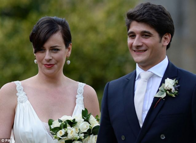 The happy couple: Alice Sheffield and her husband Etienne Cadestin pose for pictures following the ceremony