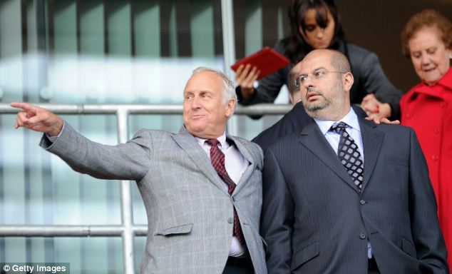 Hands on: The prince and Kevin McCabe watch United lose at Rotherham on Saturday
