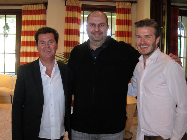All smiles: Prince Abdullah poses with David Beckham and Simon Fuller last year