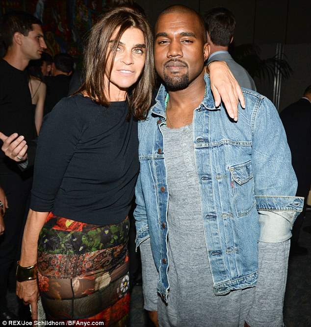Party time: On Thursday night Kanye the 36-year-old - wearing the same denim jacket - was seen chatting away to the former editor of Paris Vogue, Carine Roitfeld at the Mademoiselle C premiere after party
