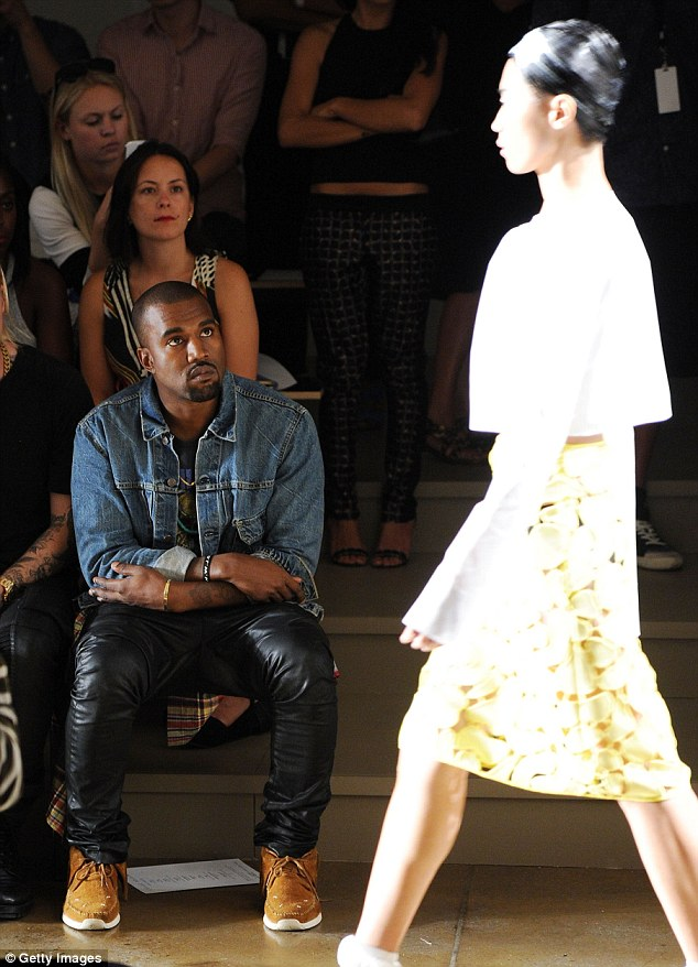 Don't rate it? Kanye remained expressionless, making it hard to gauge how he felt about the designer's, and his former collaborator, sleek but sporty looks