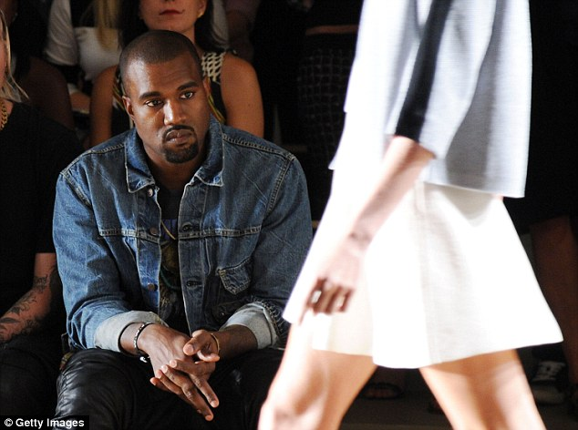Fashion fever: Kanye West made his first front row appearance at New York Fashion week on Saturday attending the Louise Goldin show