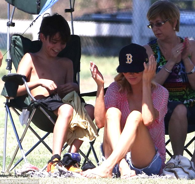 Distraction: Brandi distracted herself from the potentially awkward situation by laughing with her younger son Jake