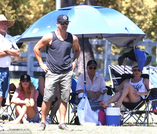 Caught in the middle: Eddie Cibrian wisely kept attention on his son's soccer game which he attended with his former wife Brandi and current spouse LeAnn