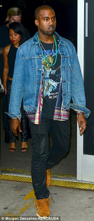 Working it: Kanye tapped into a little band t-shirt fashion as he left the show
