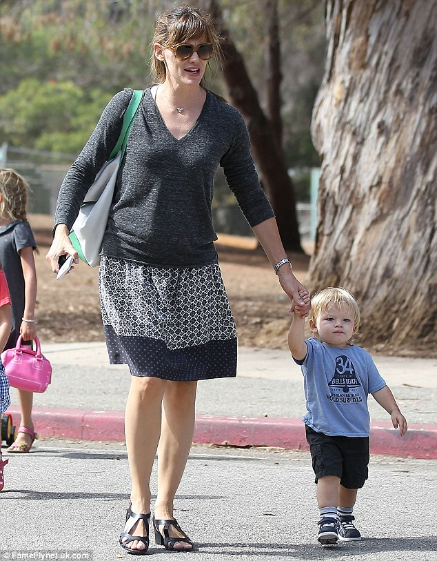 Stepping it up: Jennifer, pictured here last week with her son Samuel, tends to stick to duller shades when she is out and about with the children in Los Angeles
