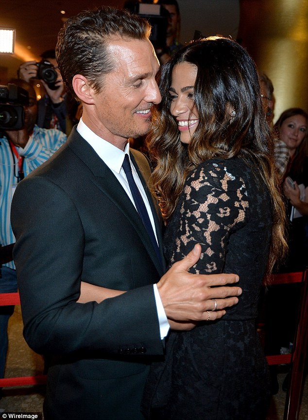 It's love! Matthew McConaughey and his wife Camila Alves arrive cuddled up on the red carpet