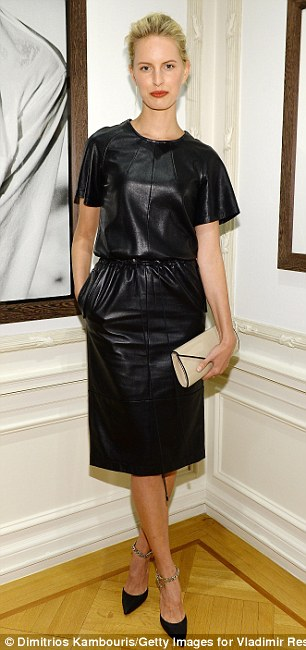 Leather mamas: Karolina Kurkova slipped her lean frame into a black leather T-shirt dress while Doutzen Kroes opted for a skater's skirt, ultra sheer vest, and red gladiator heels.