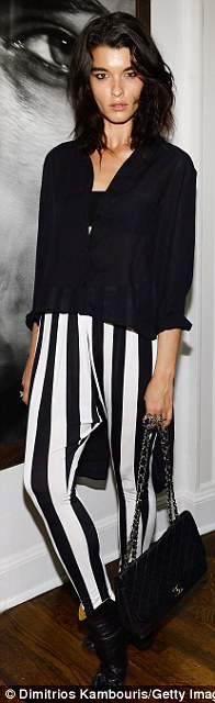 Strike a pose: Models Lily Donaldson kept it simple in a T-shirt dress, Lindsay Ellingson flashed her pins in a pencil skirt, and Crystal Renn rocked striped harem trousers
