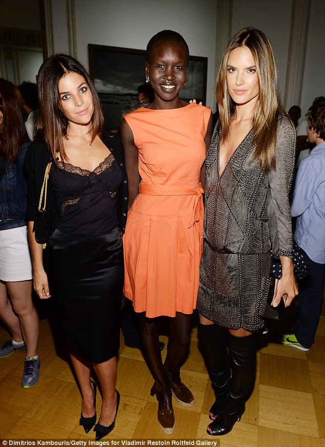 Fashionistas: Alessandra also posed alongside Carine's daughter Julia and iconic beauty Alek Wek, who was literally the only one wearing colour
