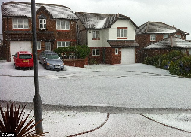 Winter wonderland: By Friday, hail storms transformed Falmouth in Cornwall