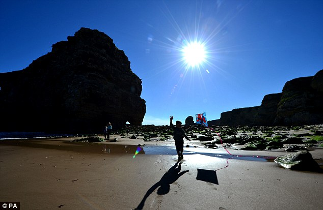 A young lad plays with his kite on Marsden Beach, South Shields, earlier today. Temperatures could hit 25C this week, but the heatwave is over