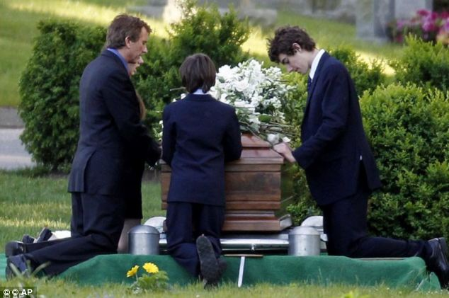 Kennedy, pictured at his wife Mary's graveside in 2012 with their children, wrote in his 2001 diary about his feelings of guilt and remorse at repeatedly cheating on her
