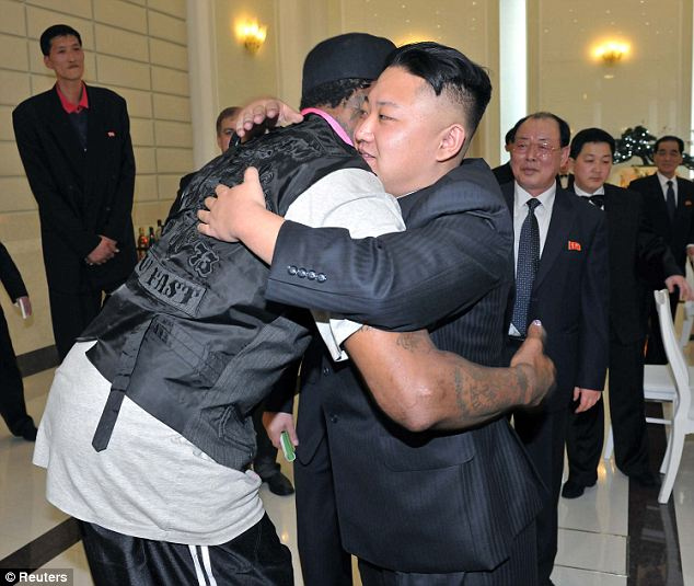 Best of friends: Rodman and Kim embrace on the NBA's previous trip to North Korea in March