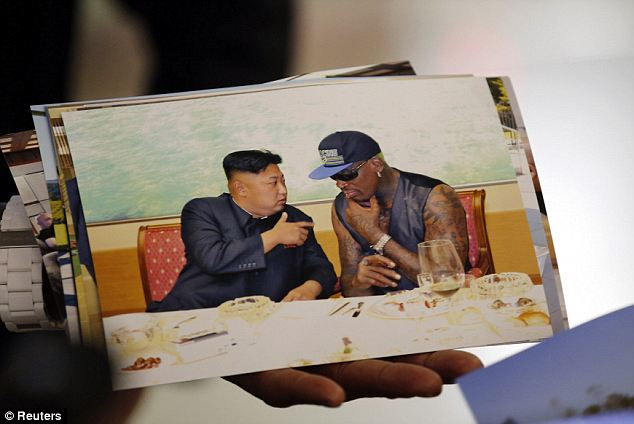 Souvenirs: In Beijing Capital International Airport, Rodman showed off pictures of him with North Korean leader Kim Jong Un
