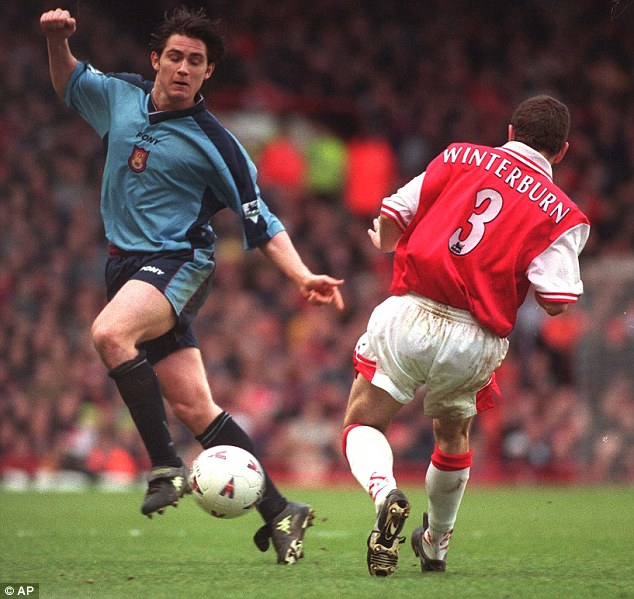 See you later: Lampard evades the challenge of Arsenal's Nigel Winterburn during an FA Cup quarter-final at Highbury in March 1998
